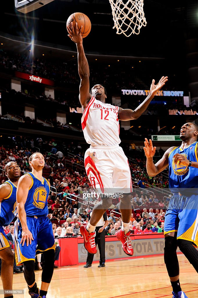 Patrick Beverley #12 of the Houston Rockets shoots a layup against the Golden State Warriors on March 17, 2013 at the Toyota Center in Houston, Texas.