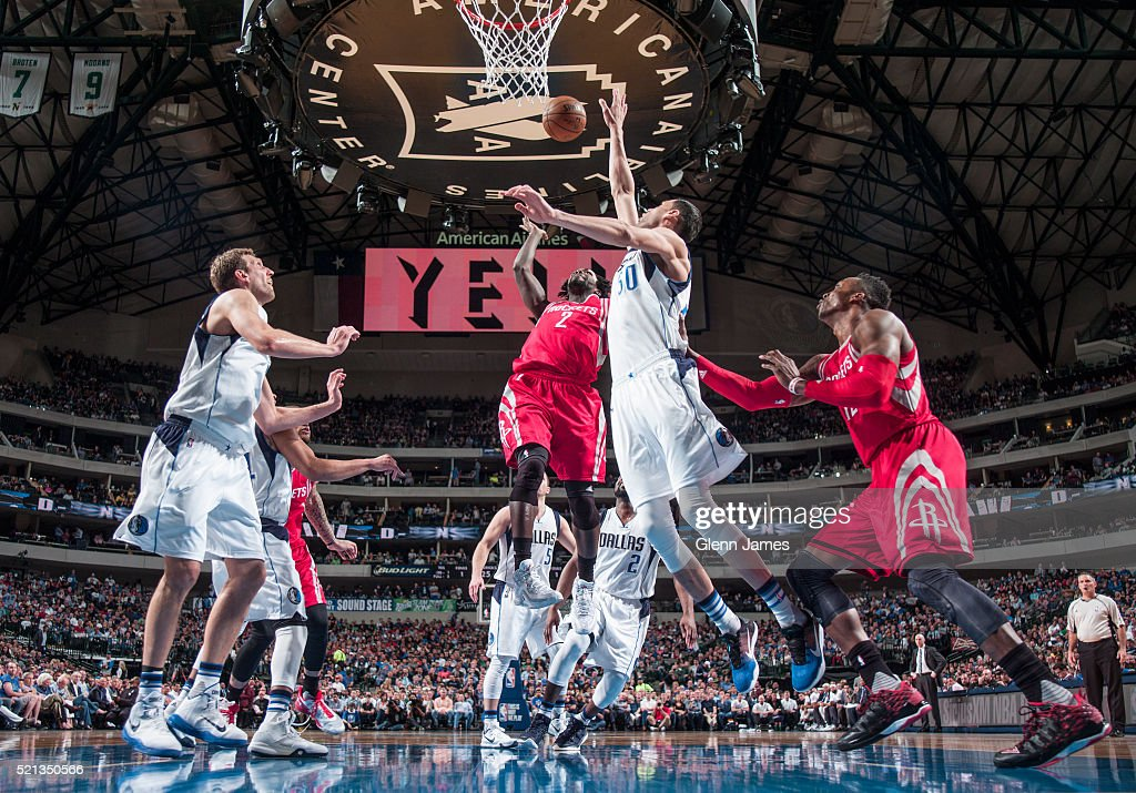 Patrick Beverley #2 of the Houston Rockets shoots the ball against the Dallas Mavericks on April 6, 2016 at the American Airlines Center in Dallas, Texas.