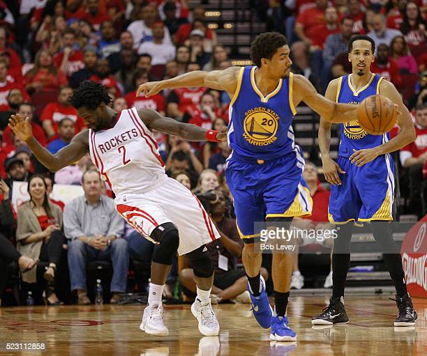 Patrick Beverley of the Houston Rockets takes a forearm from James Michael McAdoo of the Golden State Warriors in the second half at Toyota Center on...
