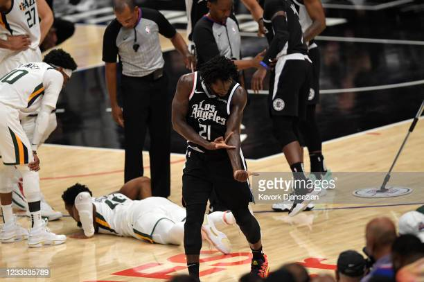 Patrick Beverley of the Los Angeles Clippers celebrate with Donovan Mitchell of the Utah Jazz on the floor after a fall during the second half of...