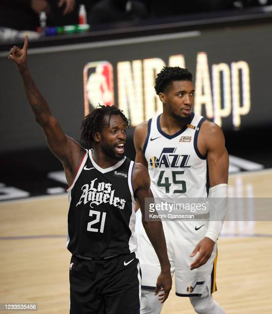 Patrick Beverley of the Los Angeles Clippers celebrates after forcing a turnover against Donovan Mitchell of the Utah Jazz during the second half of...