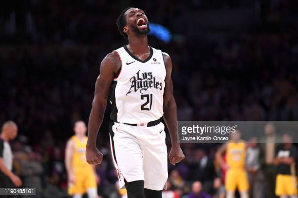 Patrick Beverley of the Los Angeles Clippers celebrates after he blocked a shot by LeBron James of the Los Angeles Lakers in the second half of the...