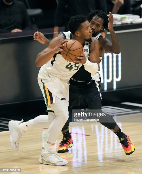 Patrick Beverley of the Los Angeles Clippers defends against Donovan Mitchell of the Utah Jazz during the second half of Game Six of the Western...