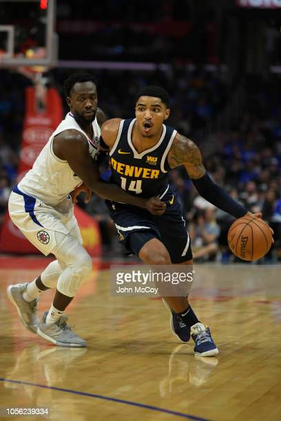 Patrick Beverley of the Los Angeles Clippers guards Gary Harris of the Denver Nuggets during the season opening game at Staples Center on October 17,...