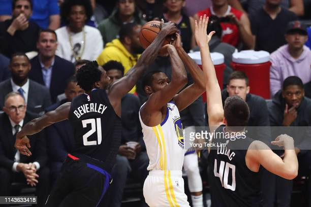 Patrick Beverley of the Los Angeles Clippers stops Kevin Durant of the Golden State Warriors from shooting the ball after being called for a...