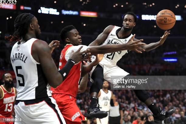 Patrick Beverley passes to Montrezl Harrell of the Los Angeles Clippers past the defense of Clint Capela of the Houston Rockets during the second...
