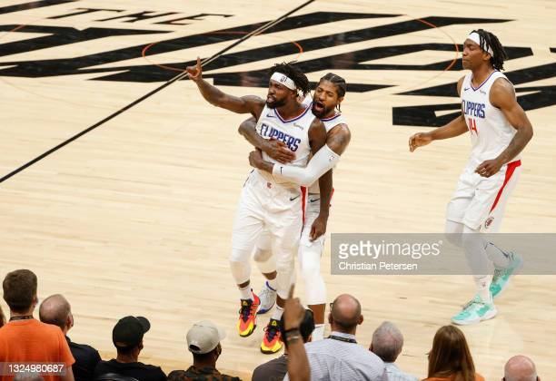 Patrick Beverley, Paul George, and Terance Mann of the LA Clippers react during the fourth quarter in game two of the NBA Western Conference finals...