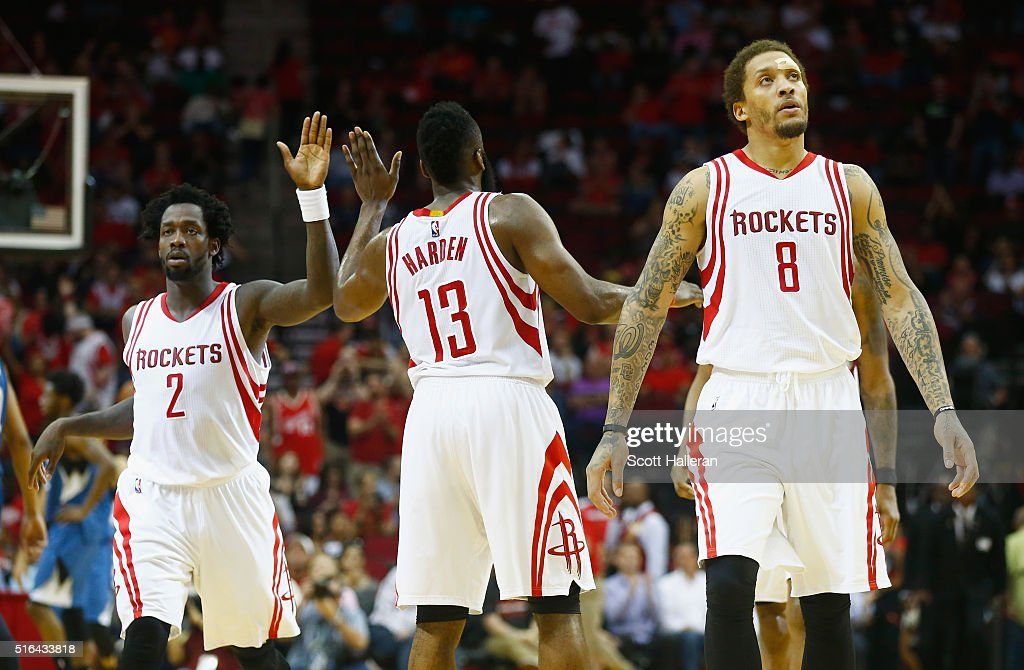Patrick Beverley #2Minnesota Timberwolves James Harden #13 and Michael Beasley #8 of the Houston Rockets wait on the court during their game against the Minnesota Timberwolves at the Toyota Center on March 18, 2016 in Houston, Texas.