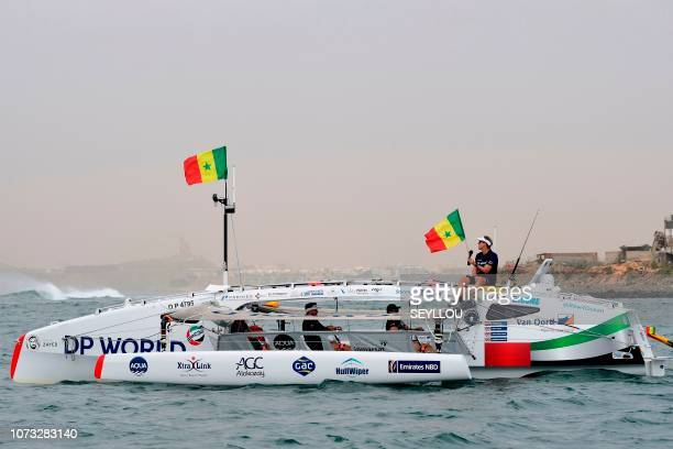 Patrick Bol Dutch skipper of the Row4ocean rowing trimaran waves to the crowd as they leave Dakar to cross the Atlantic on December 14 2018 A rowing...