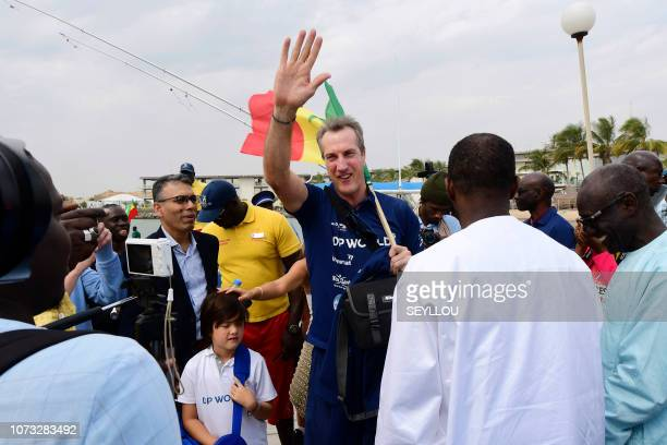 Patrick Bol Dutch skipper of the Row4ocean rowing trimaran waves to the crowd before leaving Dakar to cross the Atlantic on December 14 2018 A rowing...