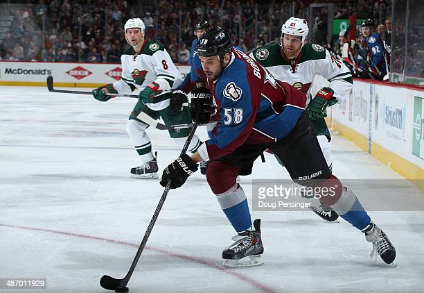 Patrick Bordeleau of the Colorado Avalanche controls the puck against Kyle Brodziak and Cody McCormick of the Minnesota Wild in Game Five of the...