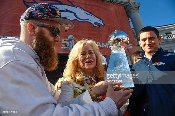 Patrick Bowlen hands over the Super Bowl trophy to his mom Annabel Bowlen during the celebration The Denver Broncos celebrated their Super Bowl...