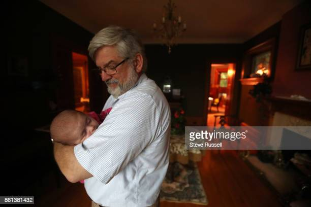 FALLS ON OCTOBER 14 Patrick Boyle holds his granddaughter Grace Joshua Boyle's children in their grandparents home after arriving back in Canada...