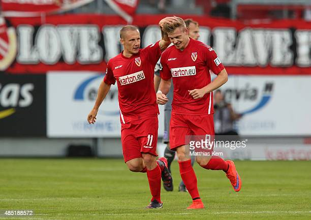 Patrick Breitkreuz of Cottbus jubilates with team mate Sven Michel after scoring the first goal during the third league match between FC Energie...
