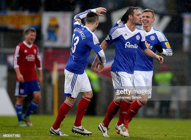 Patrick Breitkreuz of Kiel celebrates with team mates Marlon Krause and Maik Kegel after scoring his team's first goal during the Third League match...