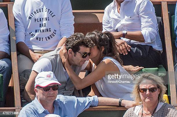 Patrick Bruel and Caroline Nielsen attend the French Open 2015 at Roland Garros on May 30 2015 in Paris France