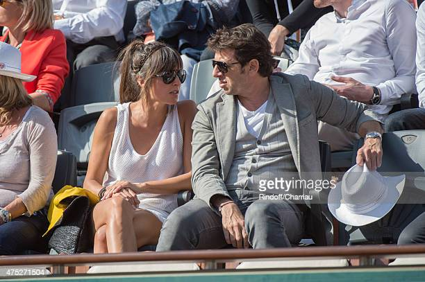 Patrick Bruel and Caroline Nielsen attend the French Open 2015 at Roland Garros on May 30, 2015 in Paris, France.