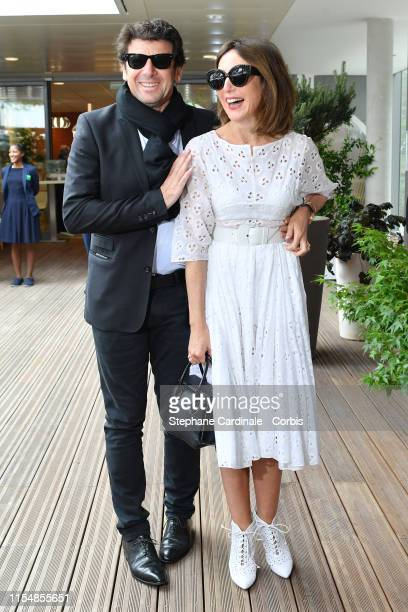 Patrick Bruel and Elsa Zylberstein attend the 2019 French Tennis Open Day Fifteenth at Roland Garros on June 09 2019 in Paris France