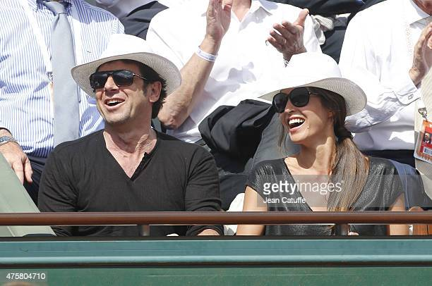 Patrick Bruel and his girlfriend Caroline Nielsen attend day 11 of the French Open 2015 at Roland Garros stadium on June 3 2015 in Paris France