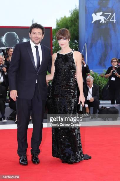 Patrick Bruel and Micaela Ramazzoti walk the red carpet ahead of the 'Una Famiglia' screening during the 74th Venice Film Festival at Sala Grande on...