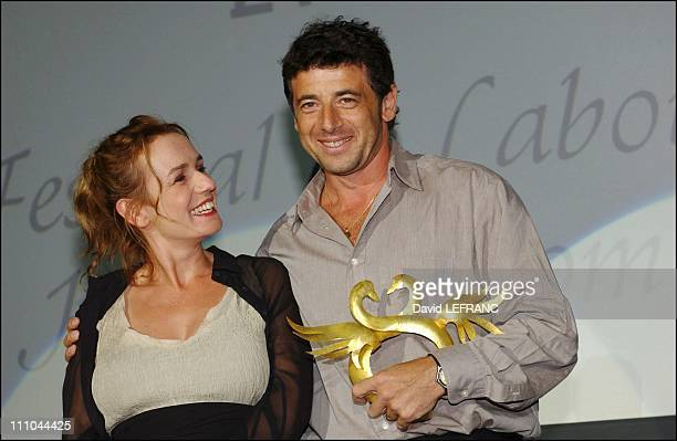 Patrick Bruel and Sandrine Bonnaire at Cabourg Romantic Film Festival in France on June 12 2004