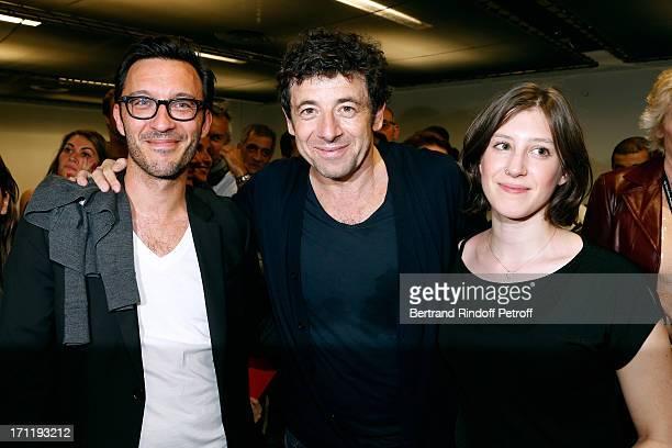 Patrick Bruel standing between Hortense d'Esteve and companion Director Pascal Duchene backstage after Patrick Bruel's last concert in Paris held at...
