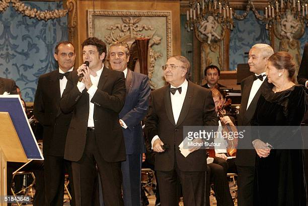 Patrick Bruel stands on stage with Robert Pariente Francois Bonaceur and Simone Weil as they attend the 'Pasteur Weizman 30th Anniversary Party' at...