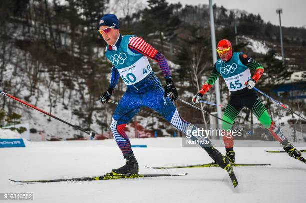 Patrick Caldwell ofUnited States and Yury Astapenka ofBelarus at Men's 15km 15km Skiathlon at olympics at Alpensia cross country stadium...