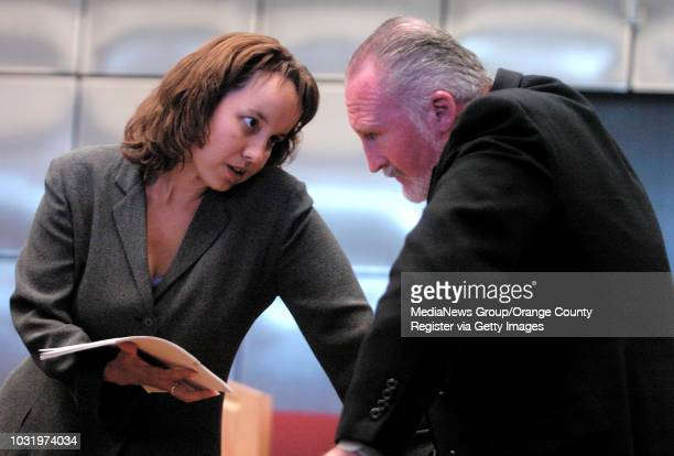 8/30/05 Patrick Callahan an assistant football coach at Cerritos College talks with his attorney Jessica Green before his arraignment in California...