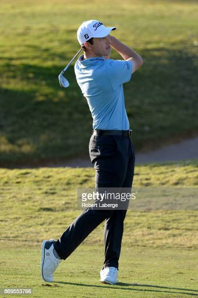 Patrick Cantlay hits his approach shot on the 12th hole during the first round of the Shriners Hospitals For Children Open at TPC Summerlin on...