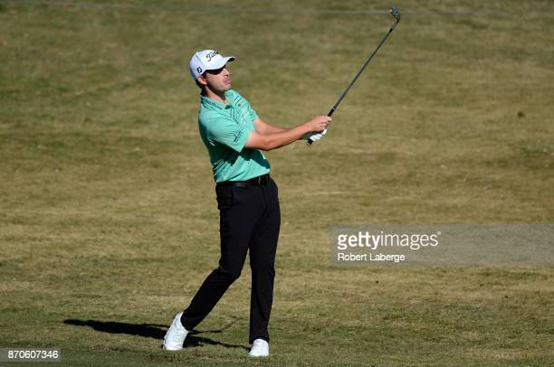 Patrick Cantlay hits his approach shot on the first hole during the final round of the Shriners Hospitals For Children Open at the TPC Summerlin on...