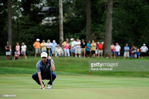 Patrick Cantlay lines up a putt on the 18th green during round three of the 2013 Hotel Fitness Championship at Sycamore Hills Golf Club on August 31...