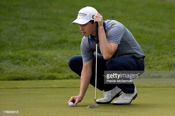 Patrick Cantlay lines up his putt on the fifth green during round three of the 2013 Hotel Fitness Championship at Sycamore Hills Golf Club on August...