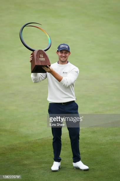 Patrick Cantlay of the United States celebrates with the trophy after winning during the final round of the Zozo Championship @ Sherwood on October...
