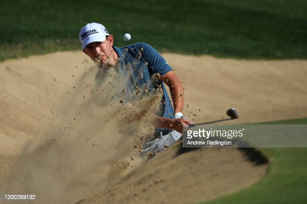 Patrick Cantlay of The United States plays a bunker shot for his third shot on the first during Day Three of the Abu Dhabi HSBC Championship at Abu...