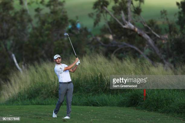 Patrick Cantlay of the United States plays a shot on the fourth hole during the third round of the Sentry Tournament of Champions at Plantation...