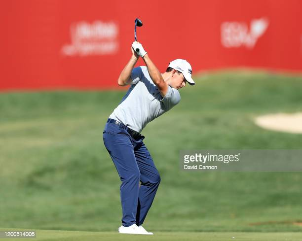 Patrick Cantlay of the United States plays his second shot on the 18th hole during the final round of the Abu Dhabi HSBC Championship at Abu Dhabi...