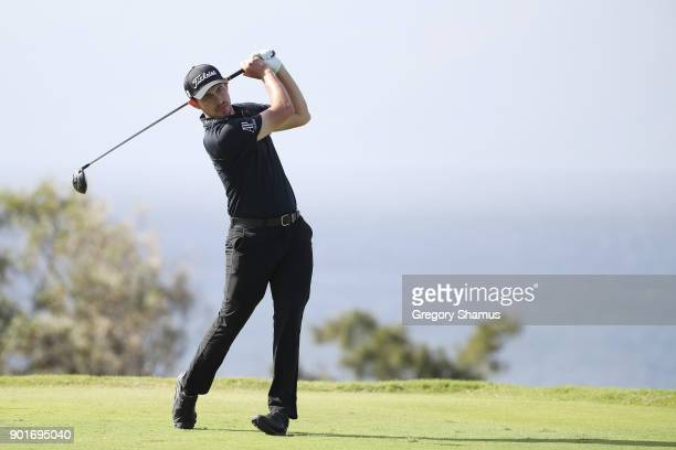 Patrick Cantlay of the United States plays his shot from the 13th tee during the second round of the Sentry Tournament of Champions at Plantation...