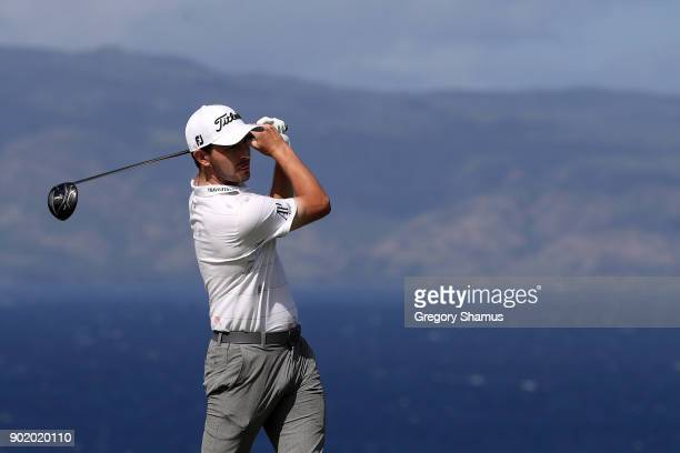 Patrick Cantlay of the United States plays his shot from the 13th tee during the third round of the Sentry Tournament of Champions at Plantation...