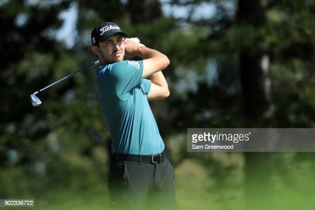 Patrick Cantlay of the United States plays his shot from the second tee during the final round of the Sentry Tournament of Champions at Plantation...