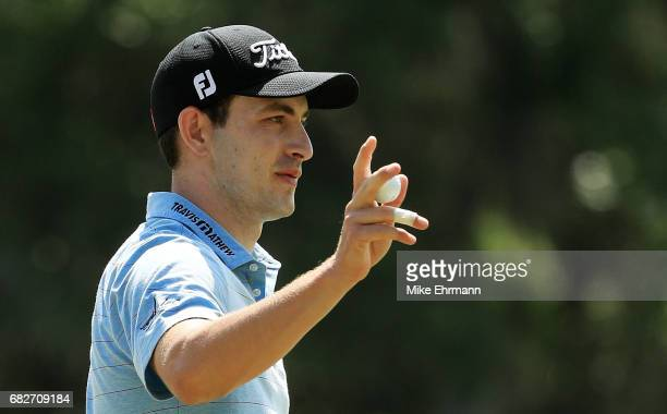 Patrick Cantlay of the United States reacts after putting on the fifth green during the third round of THE PLAYERS Championship at the Stadium course...