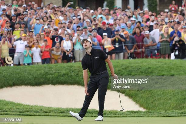 Patrick Cantlay of the United States reacts to his missed birdie putt on the 18th green during the final round of The Memorial Tournament at...