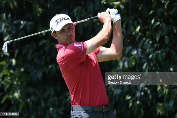 Patrick Cantlay watches his tee shot on the second hole during the first round of World Golf ChampionshipsMexico Championship at Club de Golf...