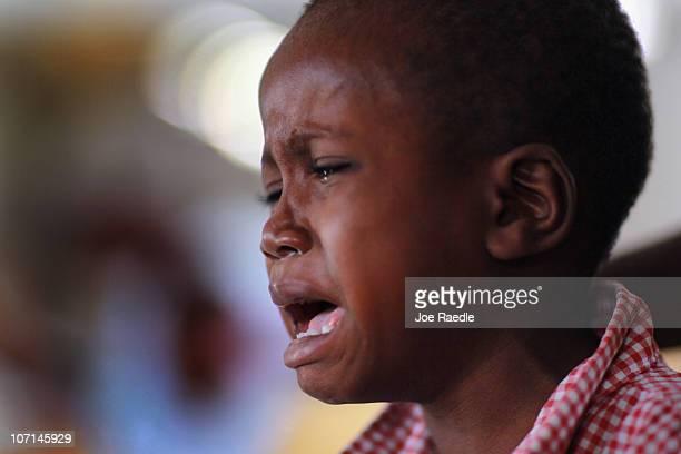 Patrick Celestin cries as he sits in a Samaritan's Purse cholera treatment facility with cholera symptoms in the slum neighborhood of Cite Soleil on...