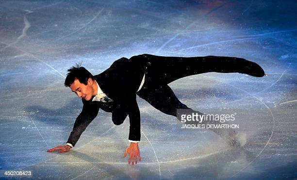 Patrick Chan from Canada falls as he performs during the figure skating closing ceremony of the 2013 Eric Bompard trophy on November 17 2013 at the...