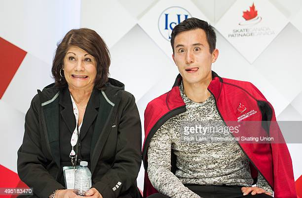 Patrick Chan of Canada and his coach Kathy Johnson make a funny face while waiting for his score in the Men Free Skate on day two of Skate Canada...