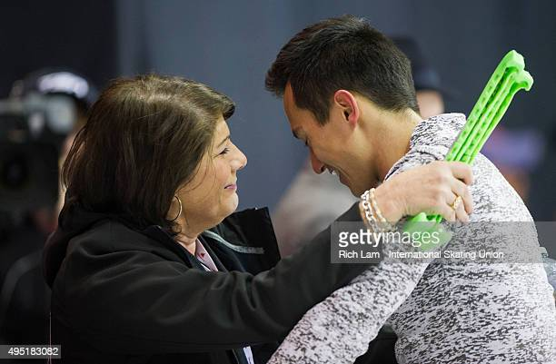 Patrick Chan of Canada and his coach Kathy Johnson share a moment after finishing the Men Free Skate on day two of Skate Canada International ISU...