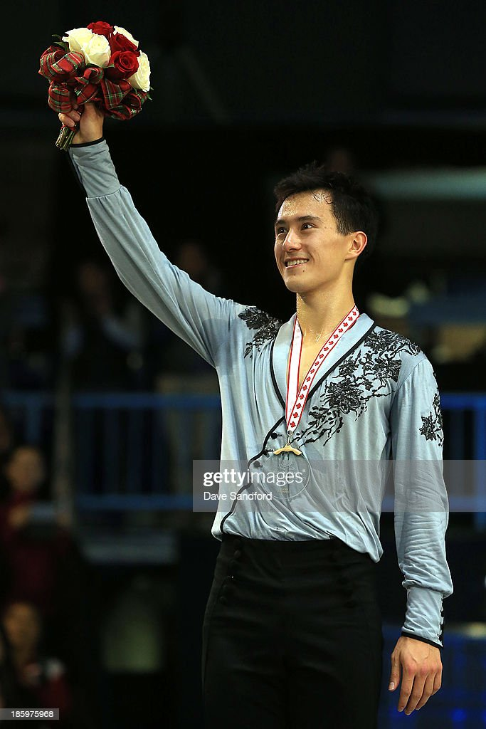 Patrick Chan of Canada celebrates his gold medal victory during the men's free program on day two at the ISU GP 2013 Skate Canada International at Harbour Station on October 26, 2013 in Saint John, New Brunswick, Canada.