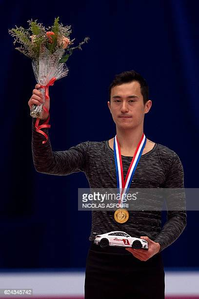 Patrick Chan of Canada celebrates with the gold medal on the podium after he won the men's free skating at the Ice Dance short dance at the Cup of...