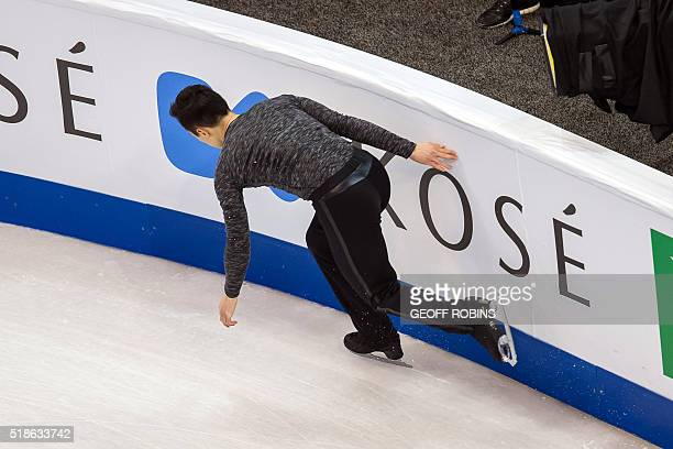 Patrick Chan of Canada collides with the boards during the Men's Free Skating Program at the ISU World Figure Skating Championships at TD Garden in...